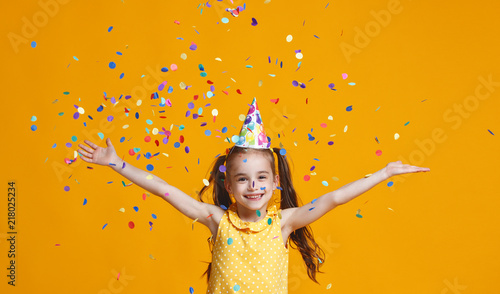 Fotobehang Carnaval happy birthday child girl with confetti on yellow background