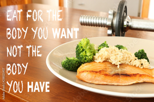 Fotografía  inspirational healthy eating quote on food and dumbbell background