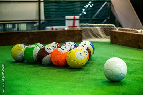 Cuadros en Lienzo Shot of foot pool balls standing on green table