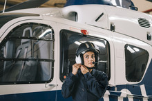 Pilot Girl Poses With Her Helicopter Wearing Helmet