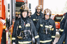 Firemen Walking At Fire Station.