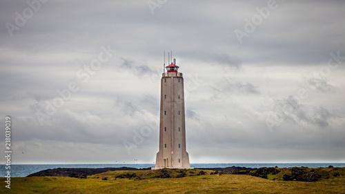 Foto op Aluminium Vuurtoren White lighthouse on the extreme west coast of Iceland.