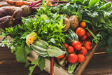 Fototapeta Tulipany - Assortment of fresh organic vegetables and garden produce on farmer market, healthy diet with vegetarian ingredients