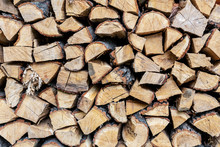 Firewood Stack Wall. Stack Of Wood Prepared For Winter And Cold Weather. Dry Chopped Oak Wood. Wooden Background Texture