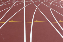 Red Sport Track For Running On Stadium Shot On Turn. Running Healthy Lifestyle Concept. Sports Background Abstract Texture