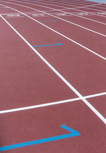 Red Sport Track For Running On Stadium Starting Marks. Running Healthy Lifestyle Concept. Sports Background Abstract Texture