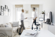 Two Busy Men Moving In Home Office