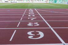 Red Sport Track For Running On Public Stadium. Running Healthy Lifestyle Concept. Sports Background Abstract Texture