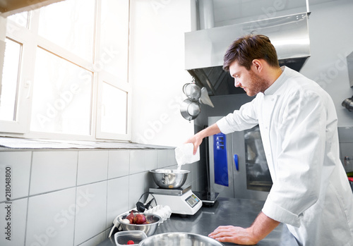 Stampa su Tela cooking food, baking and people concept - happy male chef cook with eggs pouring