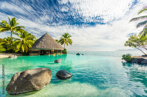 Fototapeta Infinity pool with palm tree rocks, Tahiti, French Polynesia