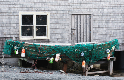 Photo  Old fishing dory and netting at Peggys Cove, Nova Scotia.