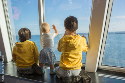 Fotografia Beautiful children, on board on ferry, traveling for a vacation