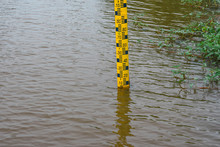 Water Level Gauge In The River To Warn Of The Amount And Risk Of Water Management.