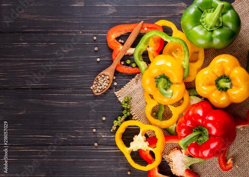 Three sweet peppers on a wooden background, Cooking vegetable salad Billede på lærred