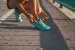 Female runner tying shoes