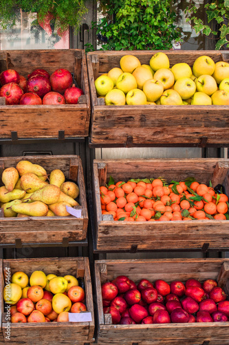 Assortment of fresh fruits and vegetables on market counter in a  wooden boxes © nataliazakharova