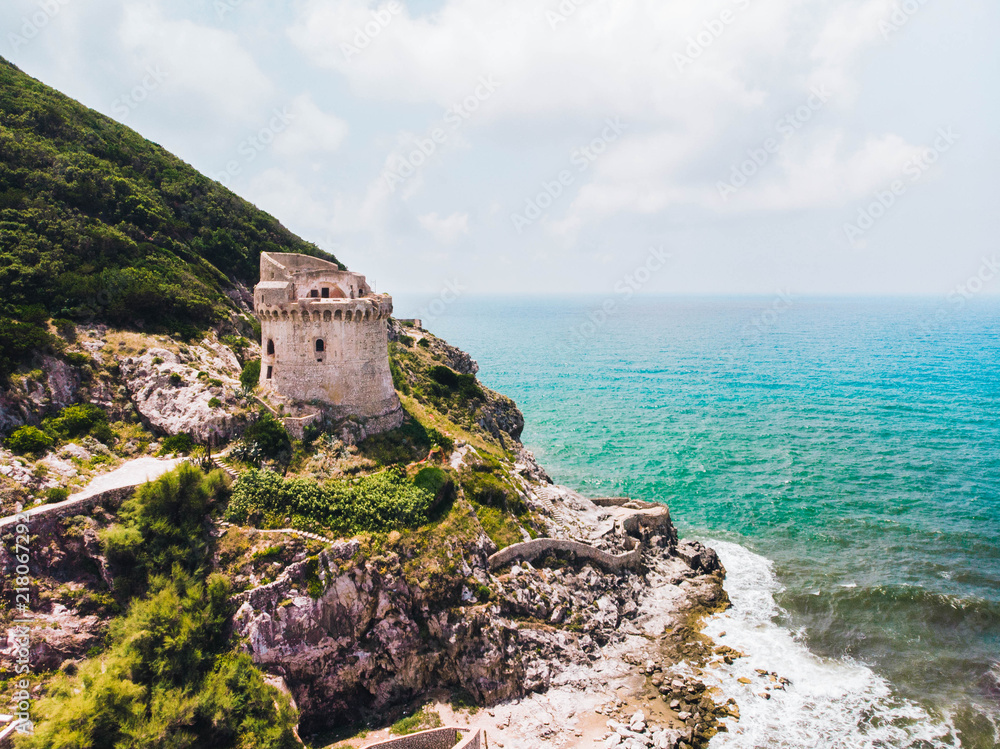 Fototapety, obrazy: Beautiful scene, old building. Ancient defense tower on mountain in the Mediterranean sea. Paola tower is placed on Circeo promontory of Sabaudia, Italy. View from drone, aerial.