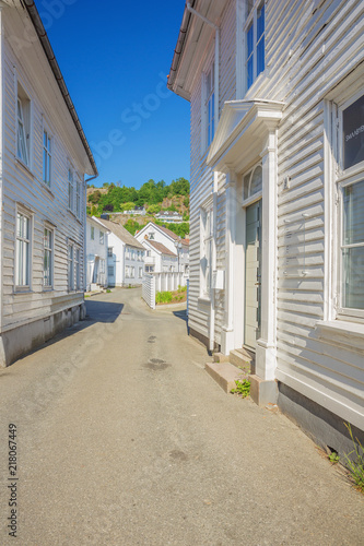 white-wooden-houses-in-a-little-alley-in-flekkefjord