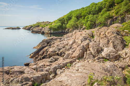 Tuinposter Kust Rugged coast near the Stapnesholen inlet on the south coast of Norway