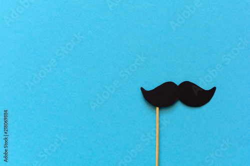 Paper mustache on booth props on blue paper background Wallpaper Mural