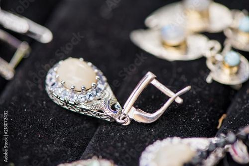 Fotografia, Obraz  Silver earrings made of tanzanite stone and fire opal