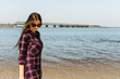 Pretty girl with long hair walking on the sea beach. Relaxation. Seascape.