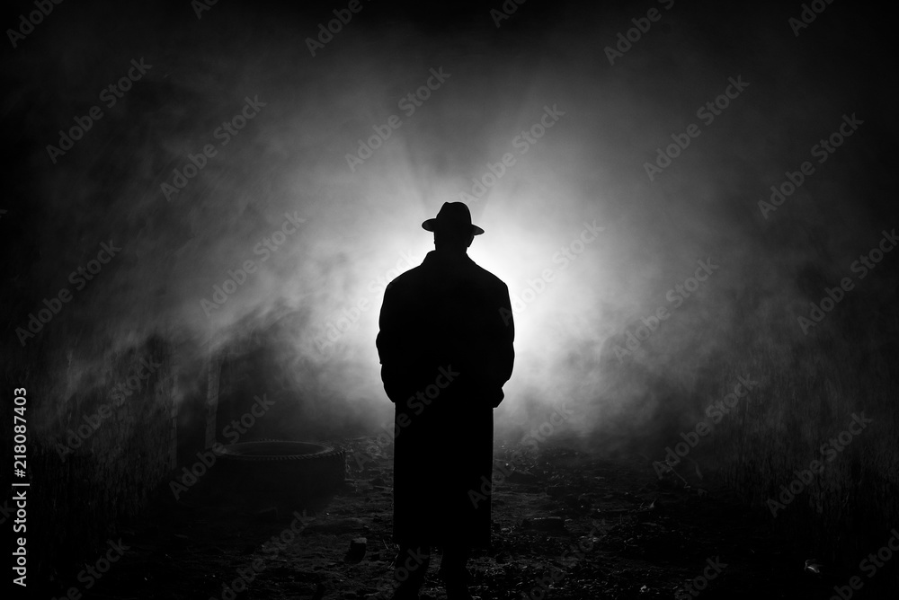 Fototapeta Backlight Silhouette of a Man in the Smoke
