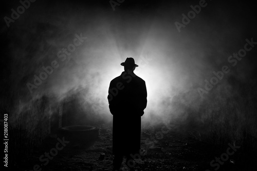 Backlight Silhouette of a Man in the Smoke