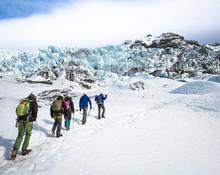 People Trekking Up Glacier