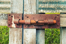 A Rusty Latch On A Wooden Gate
