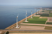 Aerial View Dutch Agricultural Landscape With Row Wind Turbines Along The Coast