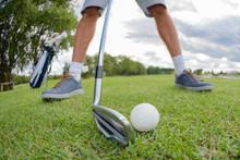 Man Poised To Strike Golfball