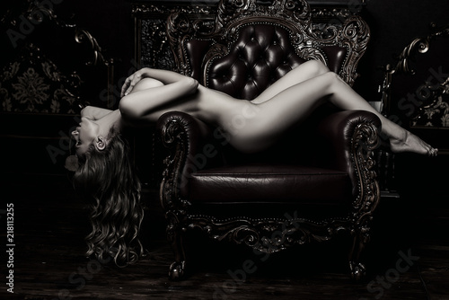 Tuinposter Akt nude girl on armchair