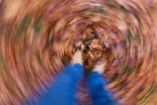 Motion Blur Feet Walking In Autumn Fall Leaves