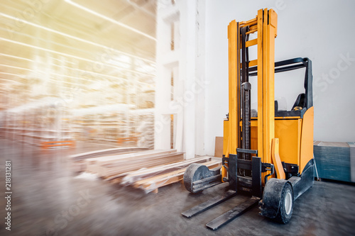 Warehouse industrial premises for storing materials and wood, there is forklift containers Fototapeta