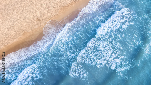 Stickers pour porte Eau Wave on the beach as a background. Beautiful natural background at the summer time. Aerial seascape from drone at the summer time