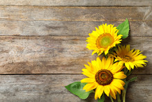 Yellow Sunflowers On Wooden Ba...