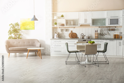 Pinturas sobre lienzo  Stylish apartment interior with kitchen furniture and sofa
