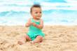 Adorable African-American girl on beach