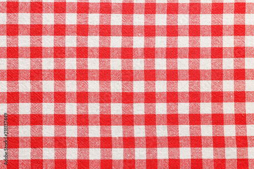Checkered picnic tablecloth as background, top view