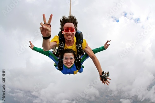 Skydiving tandem happiness on a cloudy day Canvas Print