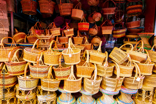 bamboo basketwork product the famous souvenir of Thailand, such as straw bags, basketwork, wicker baskets handmade in local material shop at the traditional street market Canvas Print