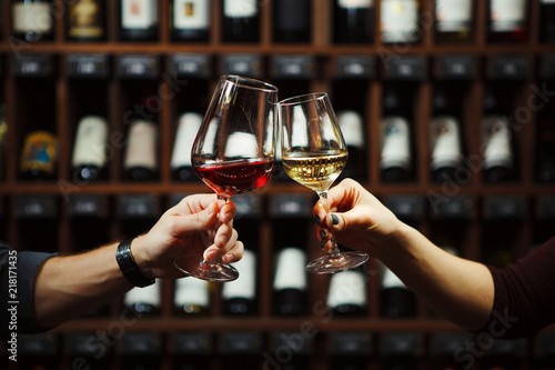 Man and woman drinking red and white wine together