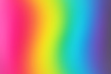 Fototapeta Tęcza - Abstract blurred rainbow background. Colorful wallpaper. Bright colors.