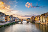 Sunrise over Ponte Vecchio in Florence, Italy, on a summer day. Colorful travel background.