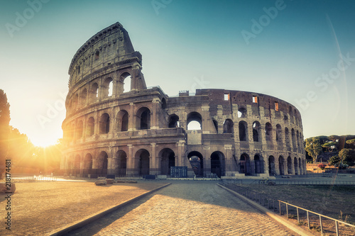 Poster Rome Colosseum in Rome, Italy at sunrise. Colourful travel background.