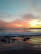 romantischer Sonnenuntergang auf Teneriffa mit Segelboot im Hintergrund
