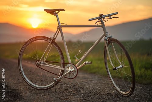 Retro bicycle on the road in sunset, detail photography of bike components