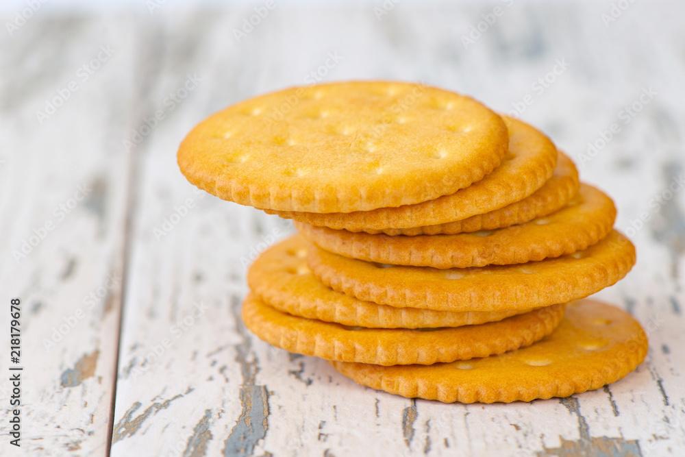 Fototapeta A few dry cracker cookies on a old wooden board