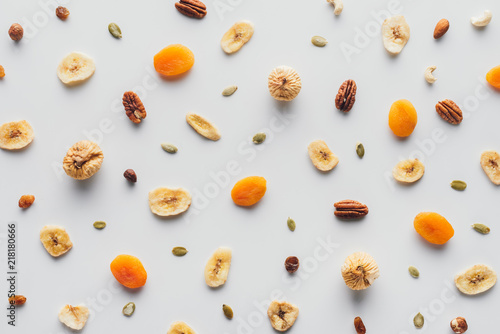 top-view-of-tasty-dried-fruits-and-nuts-isolated-on-white-background